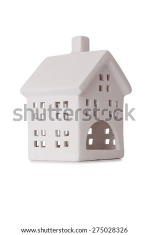 Clay toy house isolated on white - stock photo