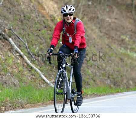 CLAYTON; GA - APRIL 14 : Julie Taylor rides in the Tour of GA Gran Fondo; April 14; 2013; in Clayton; GA. A challenging National Championship Series. - stock photo