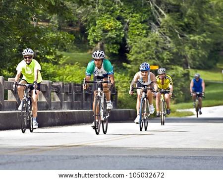 CLAYTON, GA - JUNE 9 : Unidentified cyclists in the annual Bicycle Ride Across Georgia, June 9, 2012, the Lake Burton area of Rabun County, Clayton, GA. - stock photo