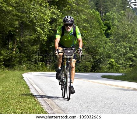 CLAYTON, GA - JUNE 9 : Unidentified older cyclist in the annual Bicycle Ride Across Georgia, June 9, 2012, the Lake Burton area of Rabun County, Clayton, GA. - stock photo