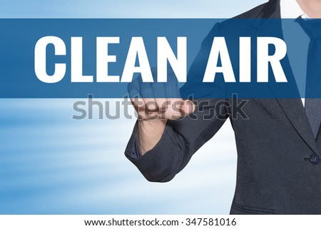 Clean Air word Business man touching on blue virtual screen - stock photo