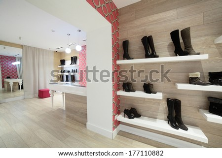 clean and bright luxury european shoes store - stock photo