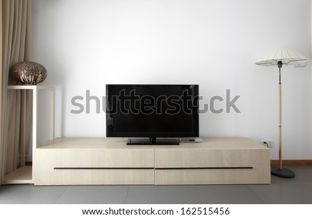 Clean and elegant home interior.TV wall - stock photo