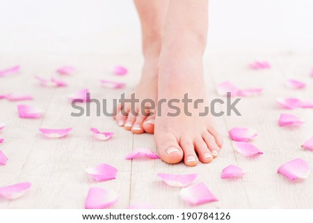 Clean and fresh feet. Cropped image of beautiful female feet on hardwood floor