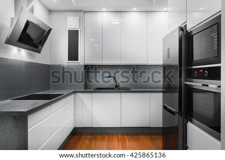 Clean and modern kitchen space in new apartment - stock photo
