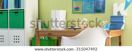 Clean and nice desk in a boy's room  - stock photo