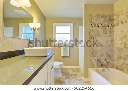 Clean and warm bathroom interior with marble tile. Northwest, USA