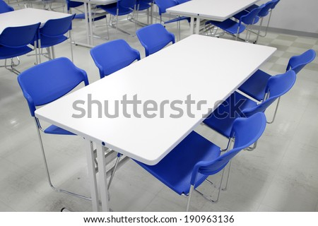 Clean cafeteria with empty seats and tables - stock photo