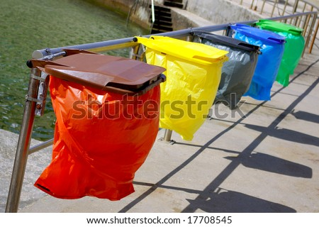 Clean colorful trash separation recycling bags - stock photo
