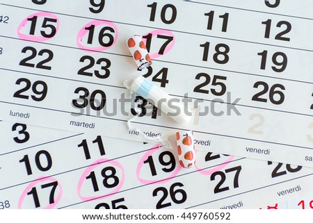 clean cotton swab on a light background calendar open tampon pack