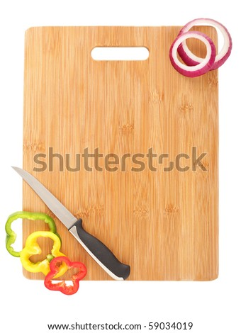 Clean cutting board, a knife and vegetable slices