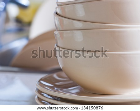 Clean dishes in kitchen sink. - stock photo