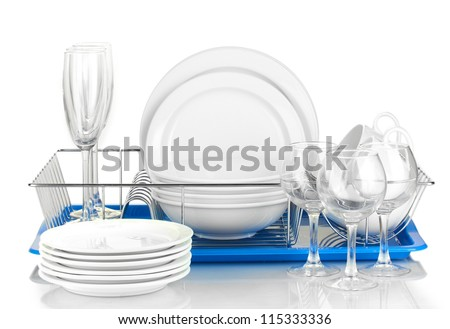 clean dishes on stand isolated on white - stock photo