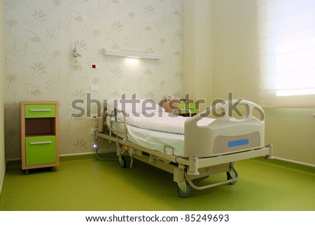 Clean empty bed in a hospital - stock photo