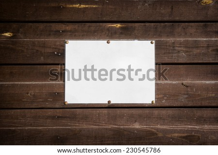 clean empty standard sheet on a wooden wall - stock photo