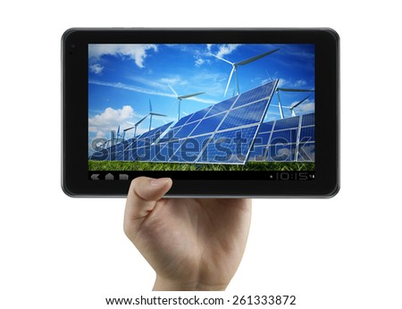 Clean energy, wind mills, solar panels show on digital tablet - stock photo