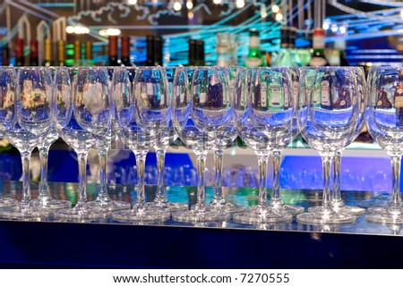 clean glasses on a bar rack