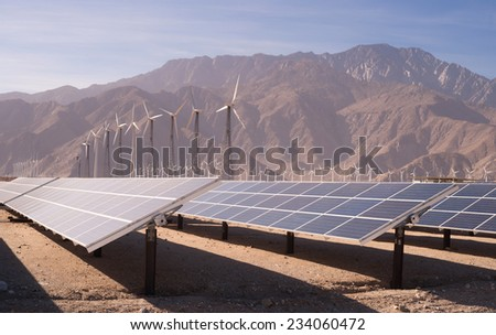 Clean Green Energy Wind Turbines Desert Solar Power - stock photo