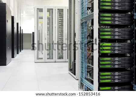 Clean industrial interior of a server room with servers - stock photo
