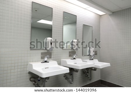 Clean new public toilet room empty - stock photo