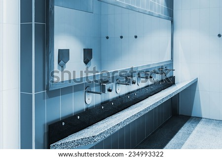 clean public washrooms interior in a shopping center. toning - stock photo
