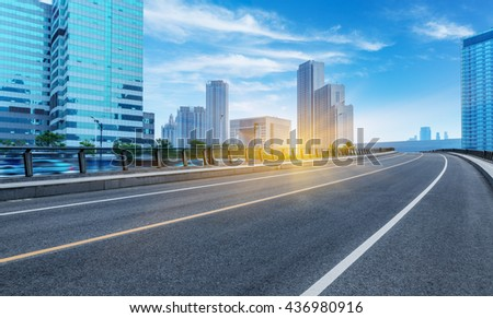 clean road with modern buildings background - stock photo