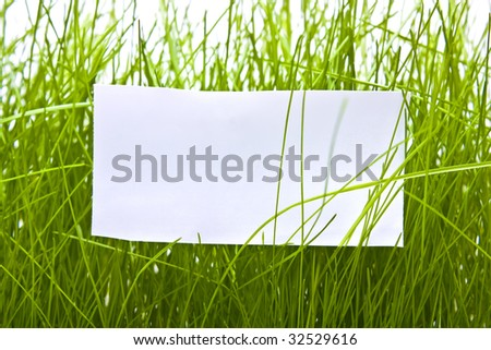 Clean sheet against a grass - stock photo