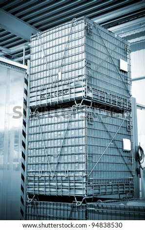 clean shiny chemical containers placed one over another at the warehouse - stock photo