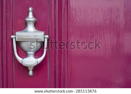 Clean silver knocker on pink background. - stock photo