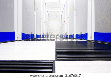 Clean suite in a data center with the perforated doors of server racks - stock photo