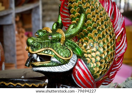 Clean the fish, a dragon. - stock photo