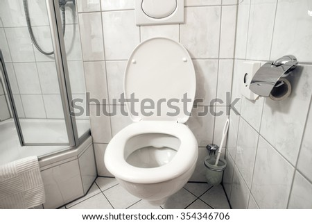 clean toilet room interior with open seat cover - stock photo