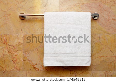 clean towel on the rack - stock photo