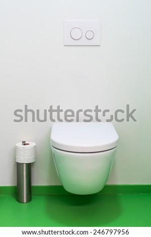 Clean urinal wc in public bathroom. - stock photo