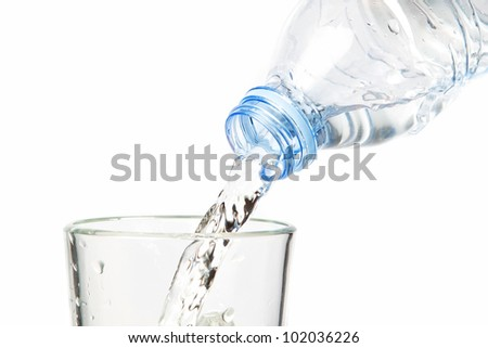 Clean water flowing into the bottle. On a white background. - stock photo