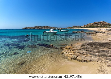 Clean Waters of Paranga Beach on the island of Mykonos, Cyclades, Greece - stock photo