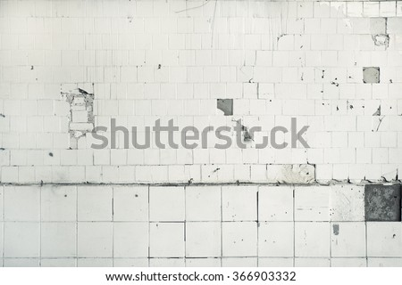 Clean white broken tile wall texture background.  - stock photo