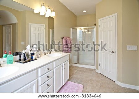 clean, white residential bathroom with shower - stock photo