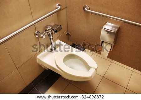 Clean white toilet stall - stock photo