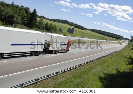 clean white truck on highway surrounded by country-side, no trademarks, stripes are just standard