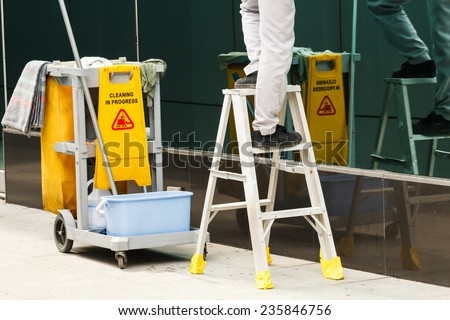 Cleaner whith cleaning in process - stock photo