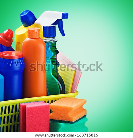 cleaners supplies and cleaning equipment on a green background - stock photo