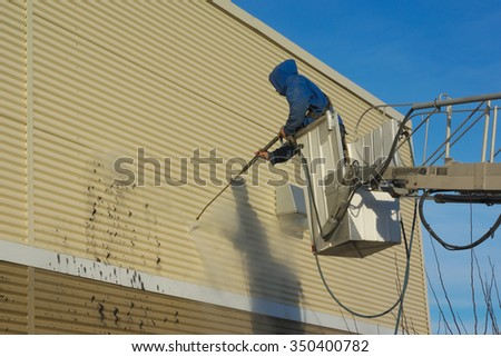 Cleaning a wall with a water jet pressure - stock photo