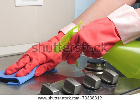 cleaning an inox gas cooker - stock photo