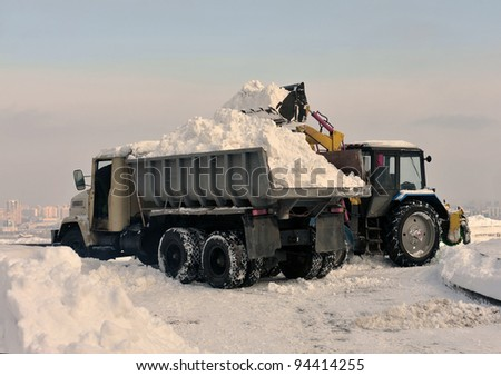 cleaning and snow loading on the truck - stock photo