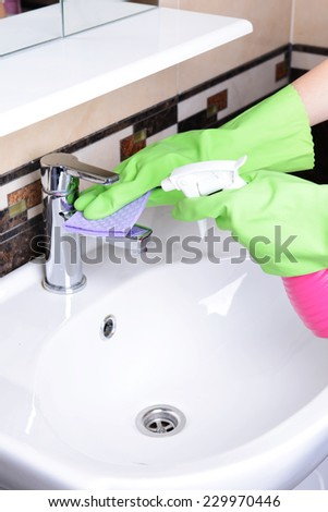 Cleaning bathroom sink close-up - stock photo