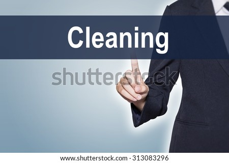 Cleaning Business woman pushing hand on virtual screen for e-commerce background - stock photo