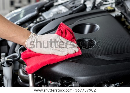 Cleaning car engine - stock photo