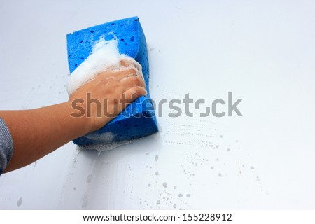 cleaning car wash with a sponge - stock photo