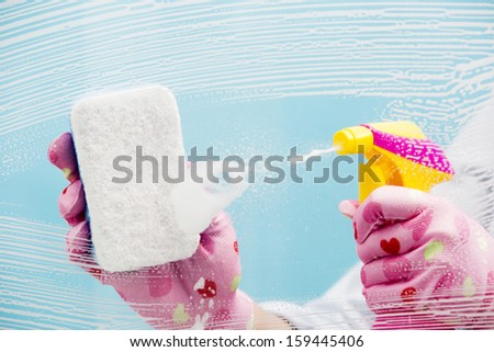 Cleaning - cleaning pane with detergent - stock photo